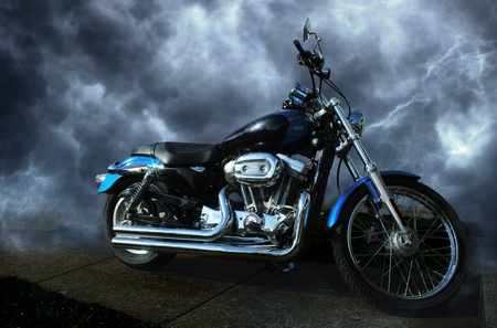 Riderless motorcycle  Clean, shiny, sparkling paint and chrome  Dynamic storm cloud background