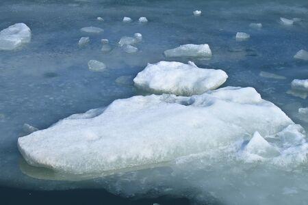 Large block of ice frozen on lake  Stock Photo