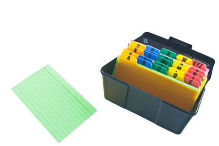 Black plastic alphabetized filing box with isolated green file card; all on white background