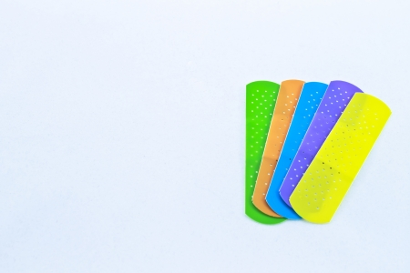 Five different colored children�s adhesive bandages