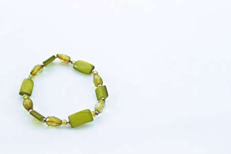 A simple bracelet composed of beautiful green stones  Stock Photo