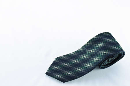 Stylish men�s tie with green hues and small square patterns  Stock Photo