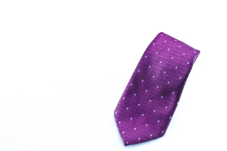 Stylish purple men�s tie displayed with room for text  Stock Photo