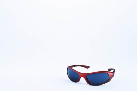 Cool sunglasses with red plastic rim, opened