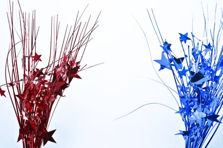 Red and blue decorative star streamers that demonstrate a festive and patriotic spirit.