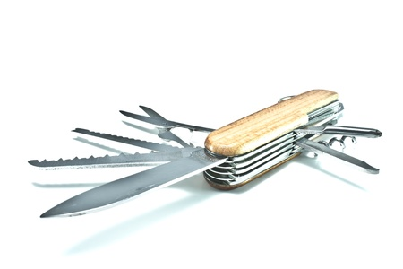 multipurpose: Open and displayed pocket knife  Stainless steel scissors, saw, screw driver, corkscrew, file, blade, and can opener  The shell is wooden   Stock Photo
