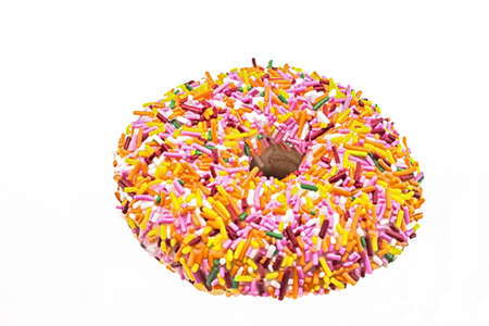 Tasty donut pastry covered in colorful and exciting rainbow sprinkles  Stock Photo