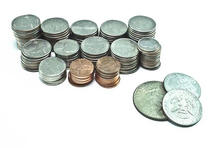 Stacks of pennies, dimes, nickels, and quarters  Different sizes  Silver dollar and two half dollars on the side