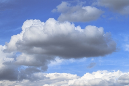 Cumulus clouds float against pretty blue sky on this humid day