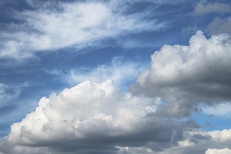 Beautiful white clouds form like cotton candy on this sunny blue sky day