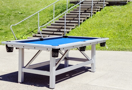 Heavy duty pool table sits outside at Buffalos canal side park