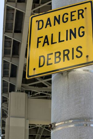 dangerous work: Danger Falling Debris sign underneath a skyway