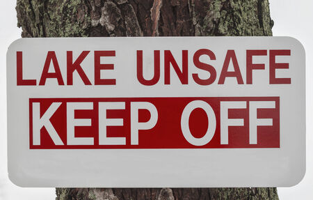 unsafe: Lake Unsafe Keep Off sign with bold red text   Stock Photo