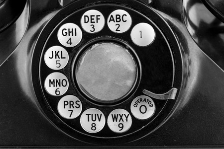 Rotary phone dial in black and white