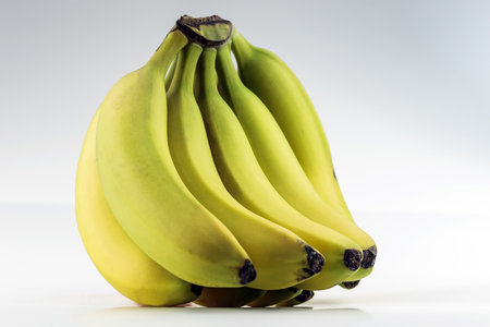 A large healthy bunch of bananas on white  Stock Photo