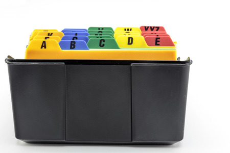 Black plastic index card filer with colorful alphabetical tab system. Stock Photo