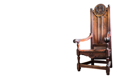 Heavy wooden antique chair. Beautiful details and craftsmanship. On white.