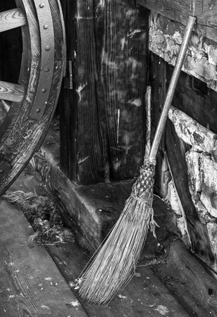 Old fashioned broom crafted with straw  Black and white for antique mood  Stock Photo