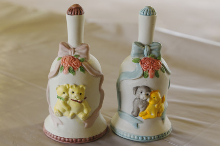 Cute and crafty ceramic bell in pink and blue. Cute teddy bear scene with flowers and ribbons.