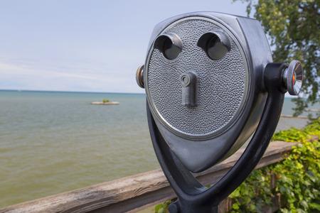 Quarter powered skyline viewer on a board walk overlooking Lake Ontario.