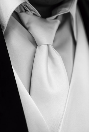 Black and white version of the grooms shirt, vest, and tie.