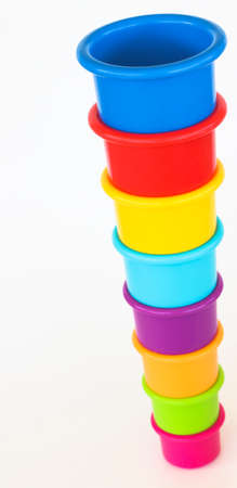 stackable: Colorful stackable cups used for toddler education and fine motor skills. Stock Photo