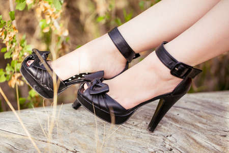 heel strap: Fashionable black high heels, pin up style.