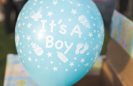 its a boy: A blue its a boy balloon from a gender reveal party. Stock Photo