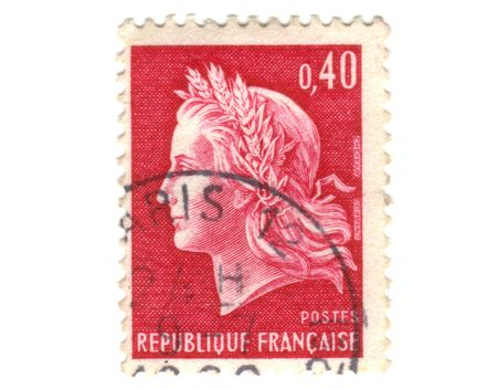 Old red french postage stamp with woman