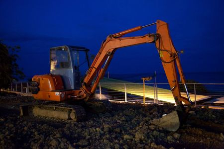 recourses: caterpillar excavator in the night Stock Photo