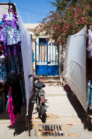Tunisian gate, market street with moped Stock Photo - 14398590