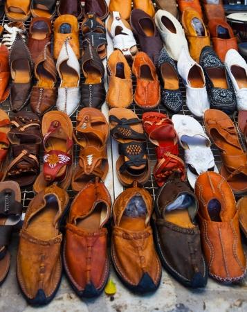 Shoes for sale on a tunisian street - Djerba Stock Photo - 14934671