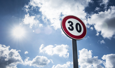 speed limit sign sunlit photo