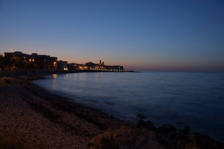 View of the Giovinazzo promenade immediately after sunset during the blue hour