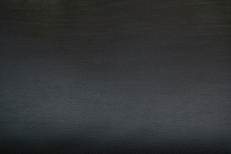 background patterns: black skin texture of sofa