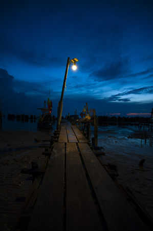 wood bridge in sea night