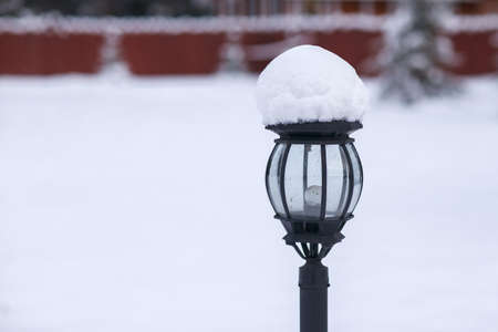 light columns: The lantern on the pole outside in the winter.