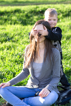 sincere girl: The boy closed his eyes mother palms.