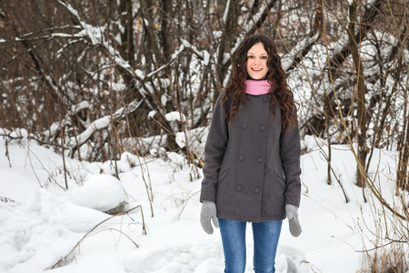 glory of the snow: Beautiful young girl cold winter outdoors