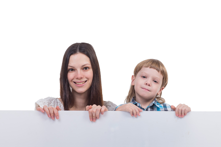 affable: Beautiful woman with a boy holding a sign on a white background