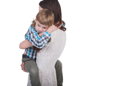 affable: Young mother holding her son at the hands of large and sad Stock Photo