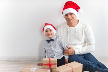 affable: Dad and son preparing for the holiday season Stock Photo