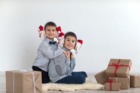 affable: Two brothers are playing with Christmas gifts