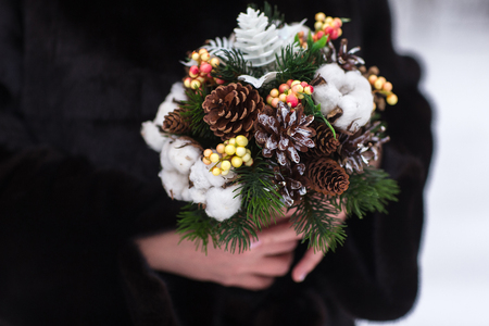 affable: wedding bouquet with pine cones. winter wedding bouquet