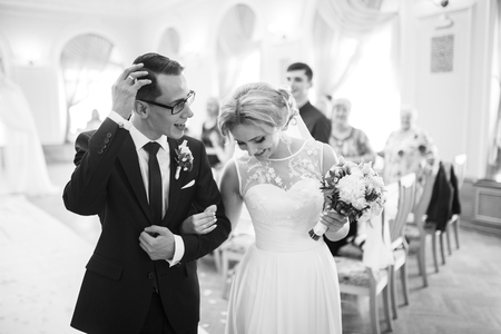 affable: Portrait of the bride and groom in a wedding dress. Happy married couple. Stock Photo