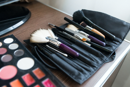 powder room: makeup brushes, closeup. Professional cosmetics for make-up artist. Stock Photo