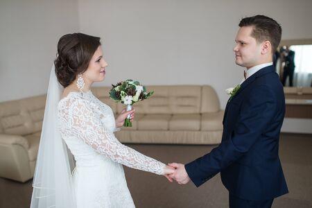 wedding theme, holding hands newlyweds in indoor