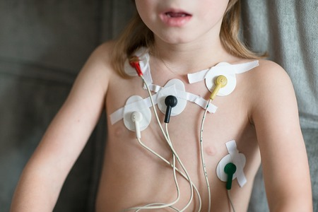 medical exam: Heart cardiogram or monitoring of cardiac performance using Holter. Child check the heart.