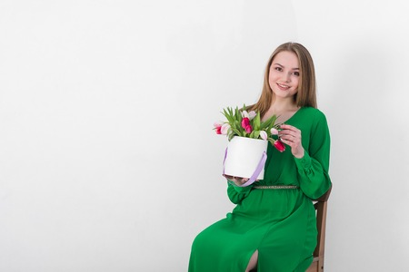 women s health: Beautiful young woman with a bouquet of flowers in a gift box. Stock Photo