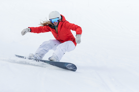 Woman snowboarder on the slopes frosty winter day. 스톡 콘텐츠